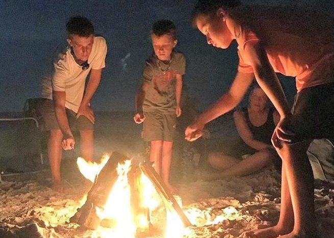 Making Smores Around A Campfire