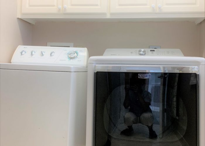Laundry Room in Main Floor- Additional Dryer on Ground Floor